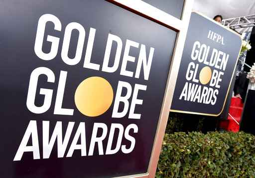 FILE - This Jan. 6, 2019 file photo shows Golden Globes signage on the red carpet at the 76th annual Golden Globe Awards in Beverly Hills, Calif. The Golden Globes will accept movies submissions without a theatrical release for the first time due to the coronavirus pandemic, the Hollywood Foreign Press Association announced Thursday. The press association said the eligibility change was temporary and would last from March 15 to April 30,