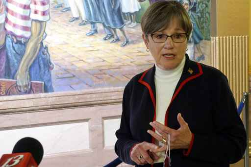 Kansas Gov. Laura Kelly answers questions from reporters about the coronavirus pandemic after a meeting with legislative leaders, Thursday, July 2, 2020, at the Statehouse in Topeka, Kan. Kelly has issued an order to require people to wear masks in public and at their workplaces. (AP Photo/John Hanna)
