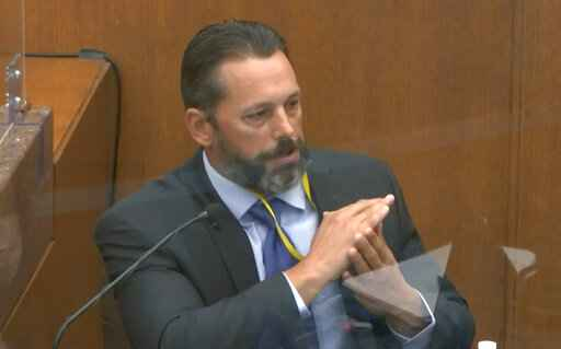 In this image from video, Minneapolis Police Lt. Johnny Mercil, a use of force trainer, testifies as Hennepin County Judge Peter�Cahill presides Tuesday, April 6, 2021, in the trial of former Minneapolis police Officer Derek Chauvin at the Hennepin County Courthouse in Minneapolis. Chauvin is charged in the May 25, 2020 death of George Floyd. (Court TV via AP, Pool)