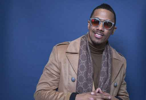 FILE - In this Dec. 10, 2018, file photo Nick Cannon poses for a portrait in New York. Cannon's