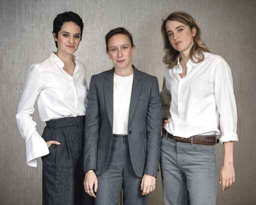 FILE - This Sept. 30, 2019, file photo shows, from left, actress Noemie Merlant, filmmaker Celine Sciamma, and actress Adele Haenel posing for a portrait in New York to promote their film,