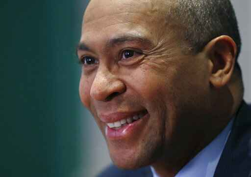 FILE - In this Dec. 15, 2014, file photo, Massachusetts Gov. Deval Patrick speaks during an interview at his Statehouse office in Boston. Former Massachusetts Gov. Patrick is considering making a late run for the Democratic presidential nomination. That is according to people with knowledge of Patrick's deliberations. (AP Photo/Elise Amendola, File)