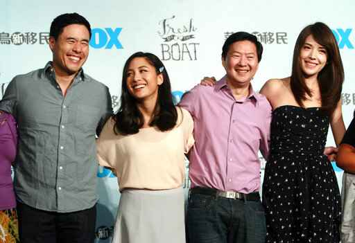 FILE - In this Aug. 5, 2016 file photo, Randall Park, from left, Constance Wu, Ken Jeong and Ann Hsu pose for photographers during a media event announcing their comedy series