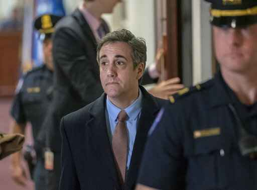 FILE - In this March 6, 2019 photo, Michael Cohen, President Donald Trump's former personal lawyer, departs the Capitol in Washington. Cohen was denied early release from a three-year prison sentence Tuesday, March 24, 2020, after he pleaded guilty to numerous charges, including campaign finance fraud and lying to Congress. (AP Photo/J. Scott Applewhite, File)