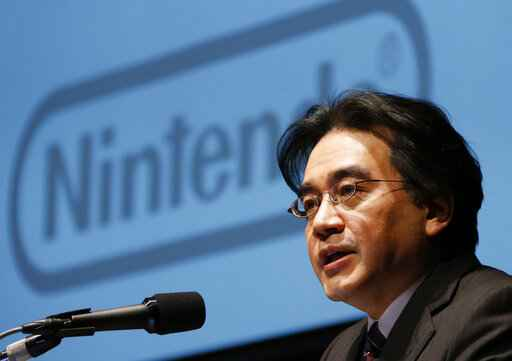 FILE - In this Jan. 31, 2013, file photo, then Nintendo Co. President Satoru Iwata speaks during a news conference in Tokyo. Nintendo's late president Iwata oversaw the video-game maker's global growth, helping make Super Mario and Pokemon household names.