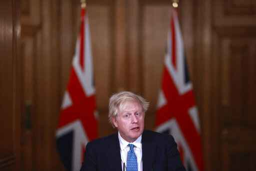 FILE - In this Jan. 5, 2021, file photo, Britain's Prime Minister Boris Johnson speaks during a news conference inside 10 Downing Street in London. World leaders, including Johnson, are condemning the storming of the U.S. Capitol by supporters of President Donald Trump. (Hannah McKay/Pool Photo via AP, File)
