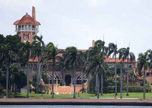 FILE - President Donald Trump's Mar-a-Lago estate is shown in a Wednesday, July 10, 2019 file photo, in Palm Beach, Fla. A Florida legislator wants President Donald Trump's Mar-a-Lago club punished for hosting a New Year's Eve party where few of the 500 guests wore masks in possible violation of local coronavirus ordinances. Democratic state Rep. Omari Hardy said Monday, Jan. 4, 2021 that Palm Beach County must take action against Mar-a-Lago out of fairness both to local businesses that have obeyed the ordinance and those punished for violating it. (AP Photo/Wilfredo Lee, File)