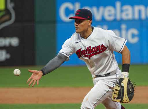 Cleveland Indians' Yu Chang tosses the ball to pitcher Aaron Civale to get Detroit Tigers' Akil Baddoo out at first base during the fifth inning of a baseball game in Cleveland, Saturday, April 10, 2021. (AP Photo/Phil Long)