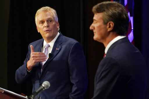 Democratic gubernatorial candidate former Governor Terry McAuliffe, left, gestures as Republican challenger, Glenn Youngkin, listens during a debate at the Appalachian School of Law in Grundy, Va., Thursday, Sept. 16, 2021. (AP Photo/Steve Helber)