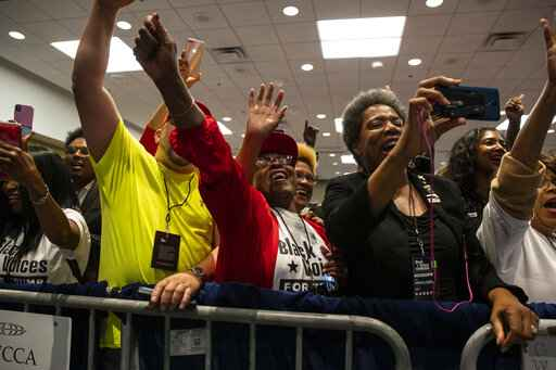 Supporters of President Donald Trump cheer as he arrives to speak during the launch of