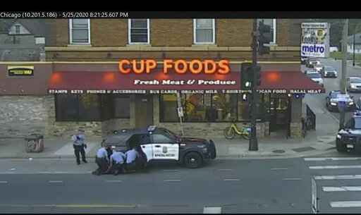 FILE - In this May 25, 2020 file image from Minneapolis city surveillance video, Minneapolis police are seen attempting to take George Floyd into custody in Minneapolis, Minn. The video was shown as Hennepin County Judge Peter�Cahill presided on Monday, March 29, 2021, in the trial of former Minneapolis police officer Derek Chauvin, in the death of Floyd at the Hennepin County Courthouse in Minneapolis, Minn. (Court TV via AP, Pool, File)