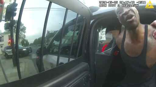 In this image from police body cam video, Minneapolis police officers attempt to place George Floyd in a police vehicle, on May 25, 2020, outside Cup Foods in Minneapolis, as it is shown Wednesday, March 31, 2021, in the trial of former Minneapolis police Officer Derek Chauvin in the death of Floyd, at the Hennepin County Courthouse in Minneapolis. (Court TV via AP, Pool)