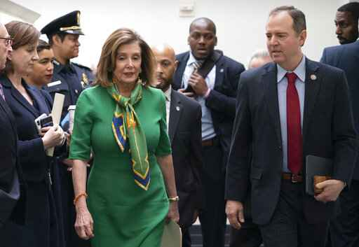 Speaker of the House Nancy Pelosi, D-Calif., joined by House Intelligence Committee Chairman Adam Schiff, D-Calif., leaves a lengthy closed-door meeting with the Democratic Caucus at the Capitol in Washington, Tuesday, Jan. 14, 2020. Speaker Pelosi is expected to appoint House impeachment managers and transmit the two articles of impeachment - abuse of power and obstruction of Congress - by the end of the week. (AP Photo/J. Scott Applewhite)