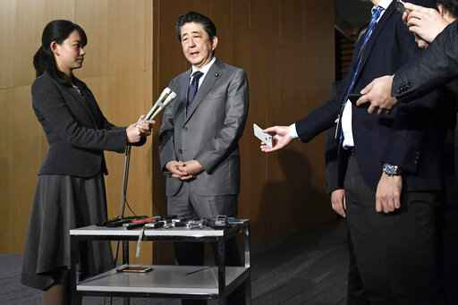 Japan's Prime Minister Shinzo Abe speaks to reporters at his prime minister's official residence in Tokyo, Feb. 21, 2020. Prime Minister Shinzo Abe should be basking in the limelight this year in the run-up to the 2020 Tokyo Olympics. Instead, the virus outbreak that has spread from China to even remote parts of Japan has Abe and his ruling Liberal Democratic Party playing defense. (Yoshitaka Sugawara/Kyodo News via AP)