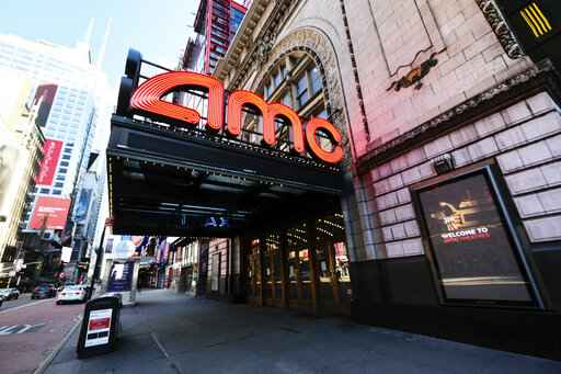 FILE -This May 13, 2020 file photo shows AMC Empire 25 theatre in Times Square in New York.  Gov. Andrew Cuomo announced limited reopening of theaters outside the city area, allowing 25 percent capacity, or a max of 50 people per screen beginning Oct. 23. (Photo by Evan Agostini/Invision/AP, File)