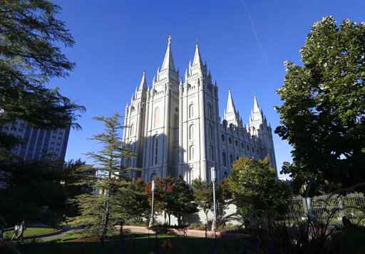 FILE - In this Oct. 5, 2019, file photo, shows The Salt Lake Temple, at Temple Square in Salt Lake City. The Church of Jesus Christ of Latter-day Saints is suspending all temple activity due to concerns over the coronavirus. The Utah-based faith said Wednesday, March 25, 2020, that the temporary suspension would start at the end of the day, said Irene Caso, a church spokeswoman. The church said the decision was made after careful consideration and