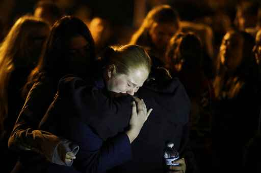 Students embrace during a vigil at Central Park in the aftermath of a shooting at Saugus High School Thursday, Nov. 14, 2019, in Santa Clarita, Calif. Los Angeles County sheriff's officials say a 16-year-old student shot several classmates and then himself in a quad area of Saugus High School Thursday morning. (AP Photo/Marcio Jose Sanchez)