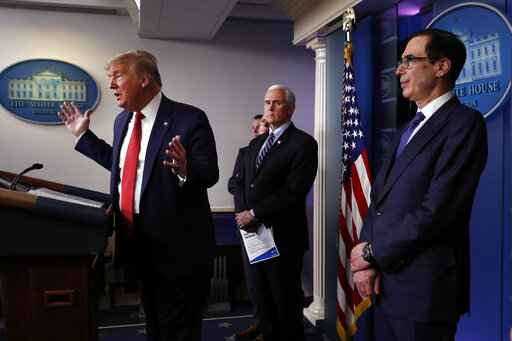President Donald Trump speaks about the coronavirus in the James Brady Briefing Room, Wednesday, March 25, 2020, in Washington as Vice President Mike Pence and Treasury Secretary Steven Mnuchin listen. (AP Photo/Alex Brandon)