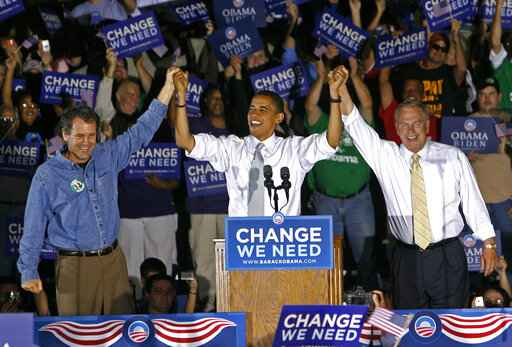 FILE - In this Oct. 9, 2008, file photo, Democratic presidential candidate Sen. Barack Obama, D-Ill., middle, is introduced by Sen. Sherrod Brown, D-Ohio., left, and Ohio Gov. Ted Strickland, right, during a rally at Shawnee State University, in Portsmouth, Ohio. As Democrats bring their primary debate to Ohio Tuesday, the question is whether the Republican foothold in Appalachia and places like industrial Youngstown is irreversible, whether Ohio is a political battleground no more. (AP Photo/David Kohl, File)