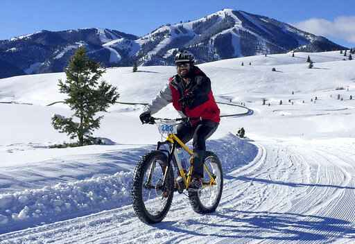 FILE - In this Jan. 30, 2016, file photo, a contestant competes in the Snowball Special fat bike race at Sun Valley Resort in Blaine County, Idaho. Three Idaho residents have become the first reported deaths in the state because of COVID-19, the illness caused by the coronavirus, state health officials announced Thursday.  Two of the cases were in Blaine County, the epicenter of Idaho's outbreak. (Chadd Cripe/Idaho Statesman via AP)