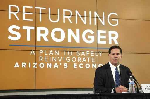FILE - In this May 20, 2020, file photo, Arizona Gov. Doug Ducey speaks during a news conference in Phoenix to give the latest updates regarding the coronavirus. While the Republican governor has never discouraged the use of masks, his full-throated endorsement of them Monday, June 29, was a big change from a largely lukewarm stance the last few months. (AP Photo/Ross D. Franklin, Pool, File)