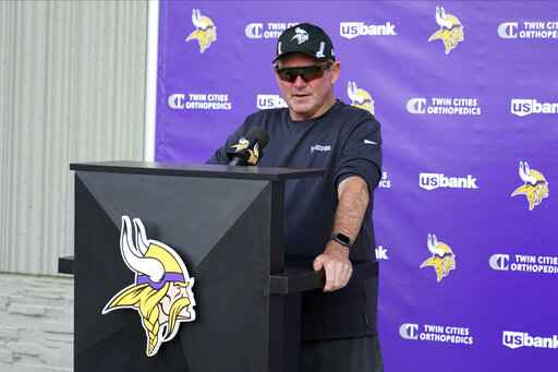 Minnesota Vikings coach Mike Zimmer speaks to reporters during the NFL football team's training camp Saturday, July 31, 2021, in Eagan, Minn. (AP Photo/Jim Mone)