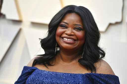 """FILE - In this Feb. 24, 2019 file photo, Octavia Spencer arrives at the Oscars  at the Dolby Theatre in Los Angeles. The Producers Guild of America will honor Octavia Spencer for her work behind-the-camera at its 2020 awards show. Spencer, who was among the producers of last year's best picture Oscar winner """"Green Book,"""" will receive the Visionary Award at the Producers Guild Awards on Jan. 18.(Photo by Jordan Strauss/Invision/AP, File)"""