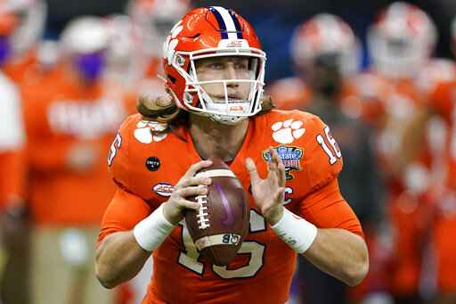 FILE - Clemson quarterback Trevor Lawrence passes against Ohio State during the first half of the Sugar Bowl NCAA college football game in New Orleans, Friday, Jan. 1, 2021. About the only certainty in the confounding 2021 NFL draft is Trevor Lawrence going to the Jaguars with the first overall pick Thursday night in Cleveland. This year's NFL draft is like none other because teams weren't able to meet face-to-face with the pool of prospects outside the lucky few who got to play in the Senior Bowl after a season that was marked by opt outs and cancellations. (AP Photo/John Bazemore, File)