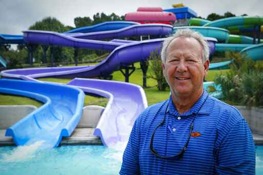 Mark Lazarus, the president and owner of Lazarus Entertainment Group, poses for a picture, Thursday, July 9, 2020, in Myrtle Beach, S.C. Businesses in beach communities and mountain getaways up and down the East Coast are fretting about a shortage of workers as the summer season picks up steam. The concern comes after the Trump administration announced in June that it was extending a ban on green cards and adding many temporary visas to the freeze, including J-1 cultural exchange visas and H-2B visas. (AP Photo/Chris Carlson)