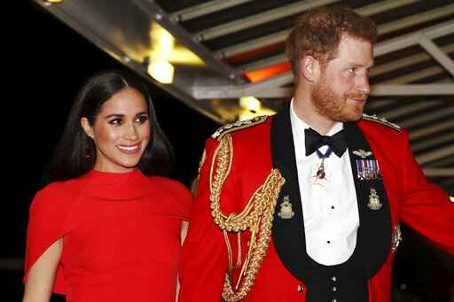 FILE - In this Saturday March 7, 2020 file photo, Britain's Prince Harry and Meghan, Duchess of Sussex arrive at the Royal Albert Hall in London. Meghan, Duchess of Sussex has her first post-royal job: narrating a Disney documentary about elephants. Disney announced Thursday, March 26 that the duchess is lending her voice to