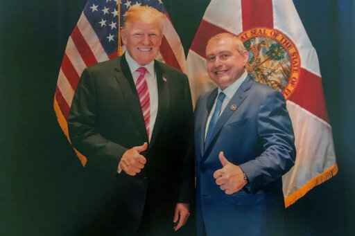 This undated image released by the House Judiciary Committee from documents provided by Lev Parnas to the committee in the impeachment probe against President Donald Trump, shows a photo of Lev Parnas with Trump in Florida. Parnas, a close associate of Trump's personal lawyer Rudy Giuliani is claiming Trump was directly involved in the effort to pressure Ukraine to investigate Democratic rival Joe Biden. Trump on Thursday, Jan. 16, 2020, repeated denials that he is acquainted with Parnas, despite numerous photos that have emerged of the two men together. (House Judiciary Committee via AP)