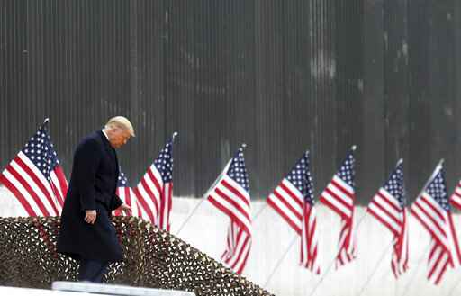 President Donald Trump walks down the steps before a speech near a section of the U.S.-Mexico border wall, Tuesday, Jan. 12, 2021, in Alamo, Texas. (Delcia Lopez/The Monitor via AP)