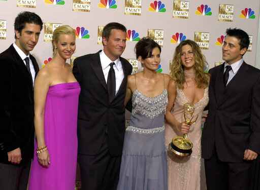 FILE - In this Sept. 22, 2002 file photo, the stars of