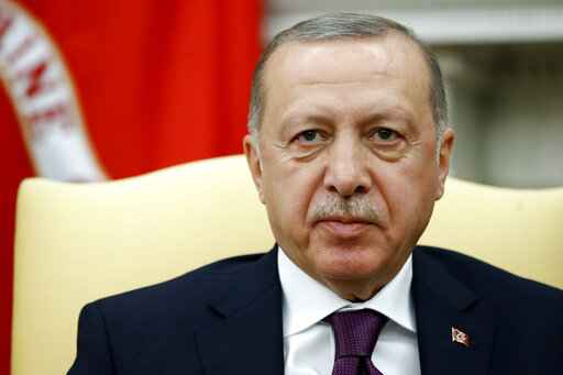 Turkish President Recep Tayyip Erdogan listens as President Trump speaks as they meet in the Oval Office with Republican senators at the White House Wednesday, Nov. 13, 2019, in Washington. (AP Photo/Patrick Semansky)