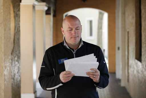 In this Tuesday, Jan. 28, 2020 photo, Leon Hayner, an associate dean of students at Rollins College looks over requests from the U.S. Census Bureau in Winter Park, Fla. Because of the federal privacy law, university administrators, if called upon, won't be able to disclose students' sex, race or Hispanic origin on the 2020 Census form. (AP Photo/John Raoux)