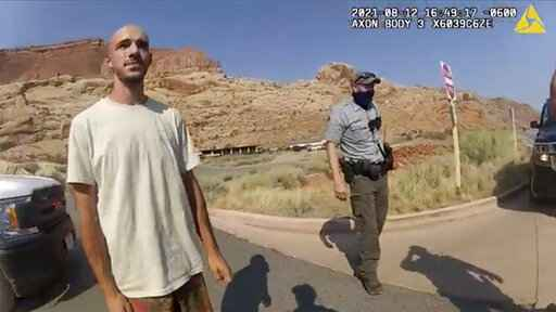FILE - This Aug. 12, 2021 file photo from video provided by The Moab Police Department shows Brian Laundrie talking to a police officer after police pulled over the van he was traveling in with his girlfriend, Gabrielle