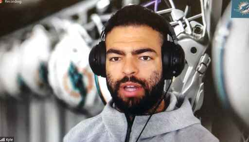 Miami Dolphins NFL football player Kyle Van Roy is shown during a Zoom news conference in this photo made in Miami Lakes, Fla., Thursday, March 26, 2020. The Miami Dolphins practiced safe distancing when they introduced eight newly acquired players hunkered down around the country, holding a series of news conferences via Zoom. The technology changed the dynamics of the conversation, and players seemed to like it. (AP Photo/Steve Wine)