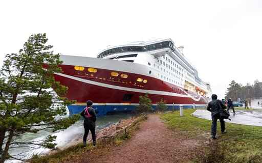 A view of the Viking Line cruise ship Viking Grace, run aground with passengers on board, south of Mariehamn, Finland, Saturday, Nov. 21, 2020. A Baltic Sea ferry with 331 passengers and a crew of 98 has run aground in the Aland Islands archipelago between Finland and Sweden. Finnish authorities say there are