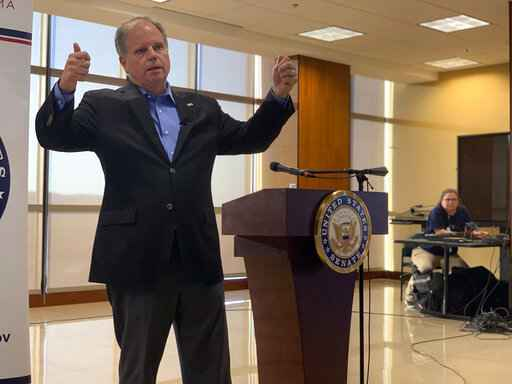 """U.S. Sen. Doug Jones addresses the House impeachment inquiry of President Donald Trump during a Sept.30, 2019 town hall on the campus of Wallace State Community College in Hanceville, Ala. The prospect of an impeachment vote in the Senate is potentially complicating an already tough election fight for the red state Democrat. """"If,"""" he said, repeating the word to emphasize the uncertainty.  """"If it comes over to the Senate, then I will vote my conscience based on the evidence and not the politics of anything."""" (AP Photo/Kim Chandler)"""