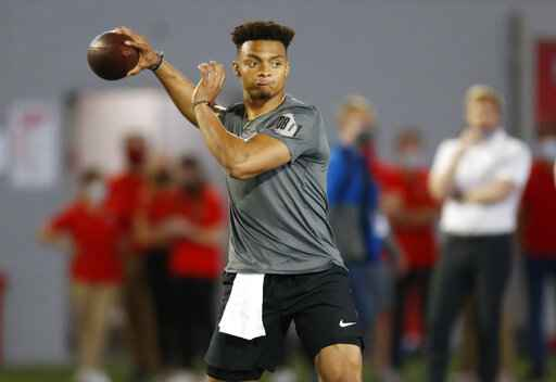 FILE - Ohio State quarterback Justin Fields throws during an NFL Pro Day at Ohio State University in Columbus, Ohio, in this Tuesday, March 30, 2021, file photo. The Division I Council meets Wednesday and Thursday, April 14-15, and at the top of the agenda - at least in terms of importance - is voting on a proposal that would grant all college athletes the right to transfer one time as undergraduates without sitting out season of competition. Some high-profile players such as quarterback Justin Fields, who transferred from Georgia to Ohio State in 2019, were granted waivers by the NCAA and it created an expectation that all players would be cleared to play right away. (AP Photo/Paul Vernon, File)
