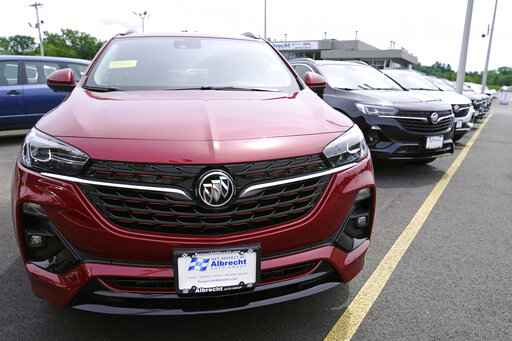 New Buick Encore SUV's displayed on the sales lot at the Albrecht Auto Group dealership, Tuesday, Aug. 3, 2021, in Wakefield, Mass. Prices for U.S. consumers rose in July at the slowest pace since February, a sign that Americans could gain some relief after four months of sharp increases that had elevated inflation to its fastest pace in more than a decade. Most economists agree that the primary drivers of higher prices have been categories of goods and services that were most disrupted by the pandemic, from new and used vehicles to hotel rooms, airline tickets and building materials. (AP Photo/Charles Krupa)