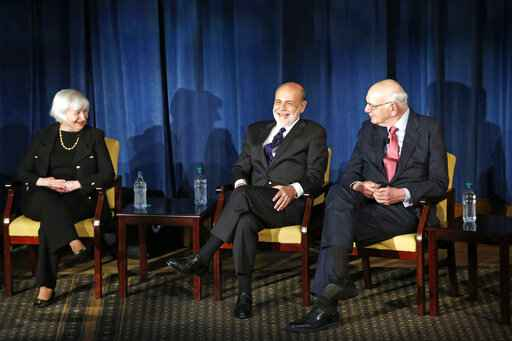 FILE - In this April 7, 2016, file photo Federal Reserve chair Janet Yellen, left, and former Federal Reserve chairs Ben Bernanke, center, and Paul Volcker, right, react as they listen to former Fed Chair Alan Greenspan appearing via video conference, during a panel discussion in New York. Volcker, the former Federal Reserve chairman died on Sunday, Dec. 8, 2019, according to his office, He was 92.�(AP Photo/Kathy Willens, File)