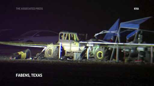 This image from a video, shows cars and tents after a vehicle plowed into a crowd at a mud racing event in Fabens, Texas, Monday, June 14, 2021. Several people were injured Sunday night after a vehicle left the mud track and crashed through a guard rail and into spectators. (KVIA via AP)