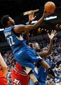 Minnesota Timberwolves� Andrew Wiggins, left, lays up a shot as he collides with Chicago Bulls� Bobby Portis in the second half of an NBA basketball game, Saturday, Feb. 6, 2016, in Minneapolis. The Timberwolves won 112-105. Wiggins scored 21 points.