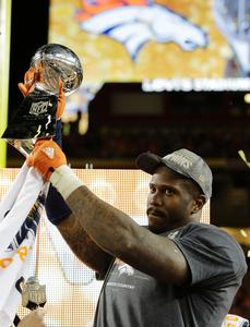 Denver Broncos� Von Miller (58) holds up the trophy after the NFL Super Bowl 50 football game Sunday, Feb. 7, 2016, in Santa Clara, Calif. The Broncos beat the Panthers 24-10.