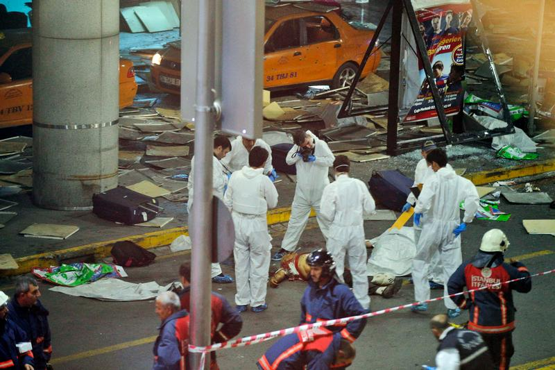 Turkish forensic police officers work at the scene of a blast outside Istanbul's Ataturk airport, late Tuesday, June 28, 2016. Two explosions have rocked Istanbul's Ataturk airport, killing several people and wounding others, Turkey's justice minister and