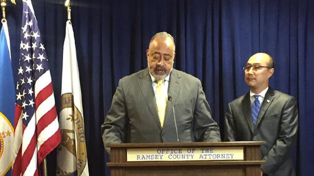 Don Lewis, left, speaks as Ramsey County Attorney John Choi looks on during a news conference Friday.