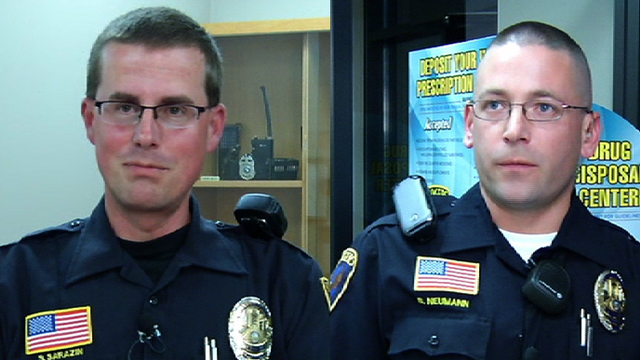 Rogers officers Steve Sarazin and Blake Neumann delivered a baby in a living room Friday morning.