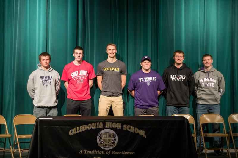 Six Caledonia seniors pose for a photo on National Signing Day
