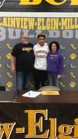 P-E-M football player Derrick Cannon (pictured center) signs with Minnesota State University, Mankato